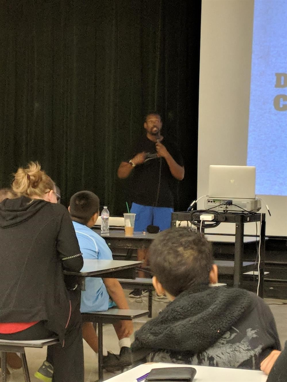 Photo of Cam Awesome presenting to MVA students.